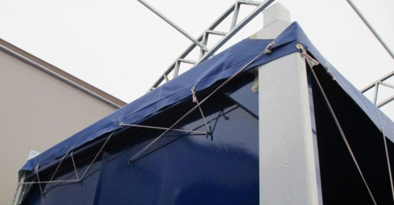 tarp-on-offshore-mini-container
